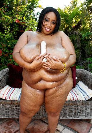 Oiled, fat black model with huge,..