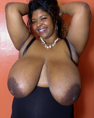 Cheerful black BBW Gina Fine playing..