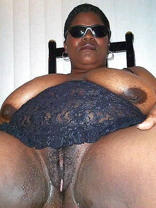 Busty black cutie with the fake huge..
