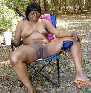 Dude fucks black MILF in the woods,..