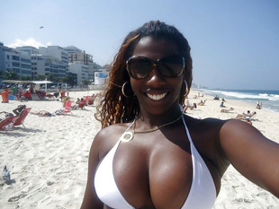 Super sexy black MILF with big tits..
