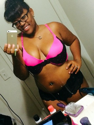 Plump black mom with piercings in the..